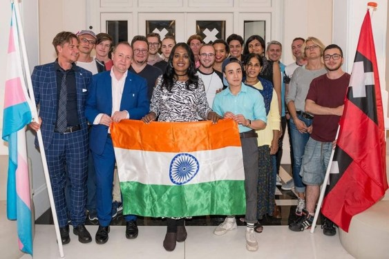 Kalki Subramaniam holds the Indian flag at Amsterdam.