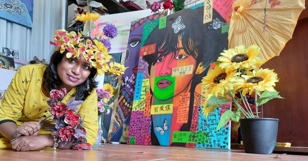 Artist Kalki Subramaniam with the Pop art painting of BTSV